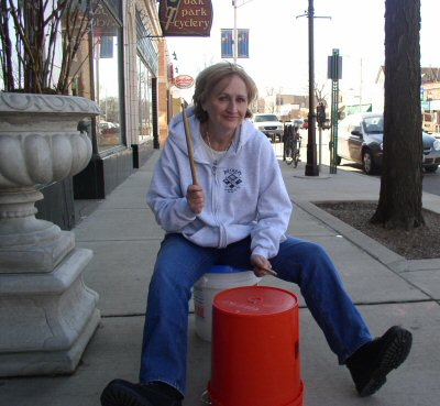 Audiologist Patricia McCarthy plays the bucket drum