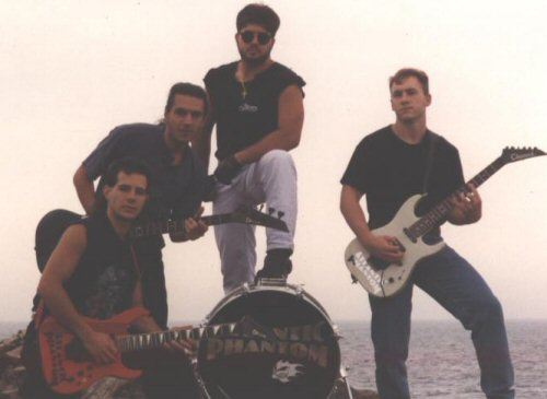 Atlantic Phantom 1994 is the promo picture for the group. From left to right are Michael Firicano (lead guitar and vocals), Joseph Ipolitto (lead vocals and bass), Mark Desimone (percussion and backing vocals), and Brian Fligor (rhythm guitar and backing vocals).